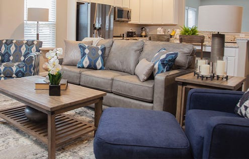 Living room scene showcasing mixed prints and blues