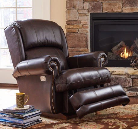 Kirkwood Rocking Recliner by the fireplace