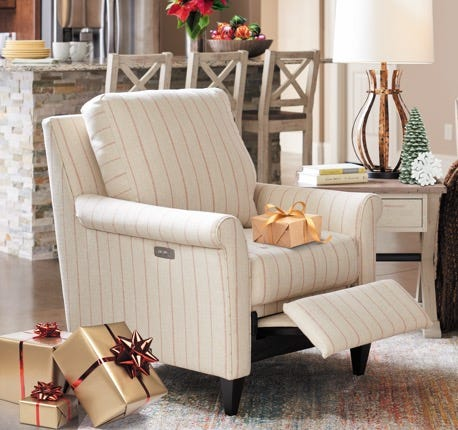 Abby duo® Reclining Chair with Christmas presents