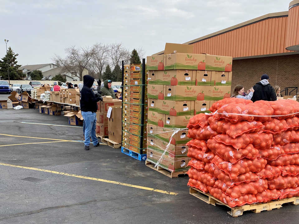 Pallets of food and workers providing meals