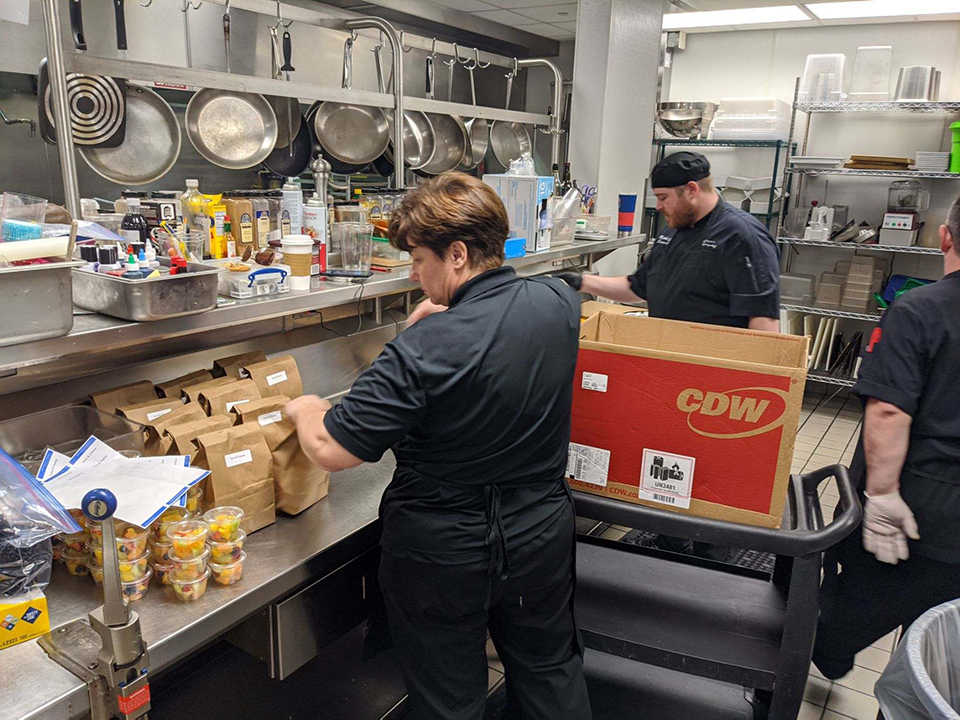 Kitchen staff packing suppers