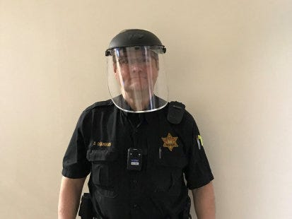 Police officer wearing face shield