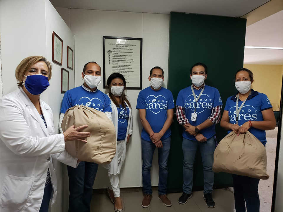 La-Z-boy team delivering masks to hospital worker