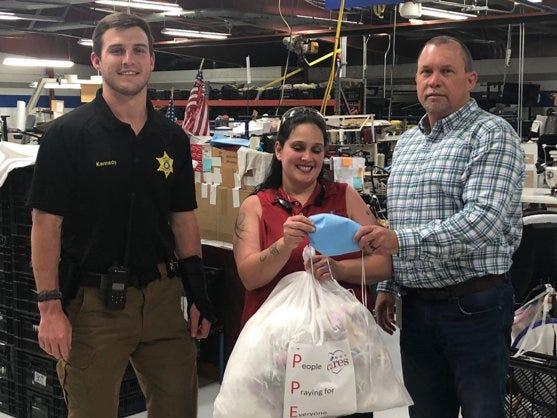 La-Z-boy employees providing protective gear to sherrif